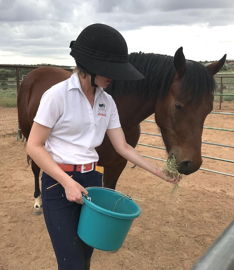 Cami feeding Taz hay